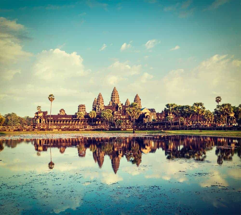 Foreground water reflecting Ankgor Temple Cambodia