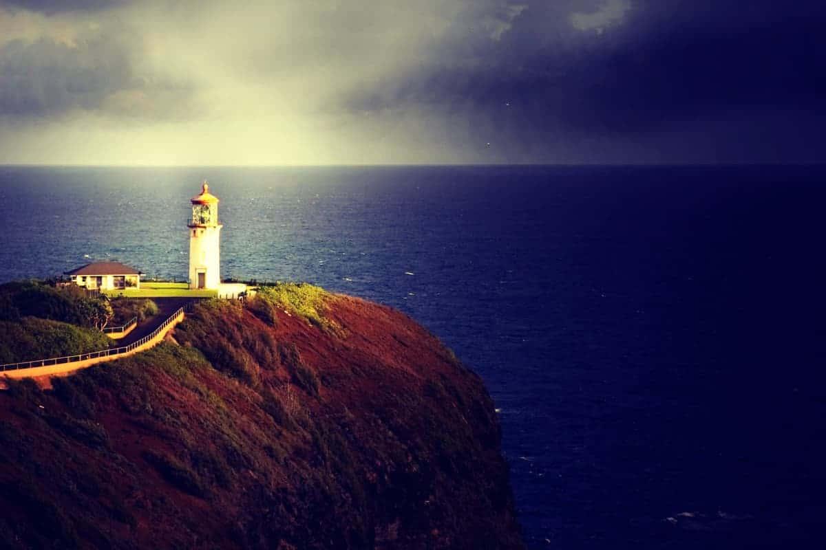 View of Kilauea Lighthouse from Secret Beach in Kauai Hawaii