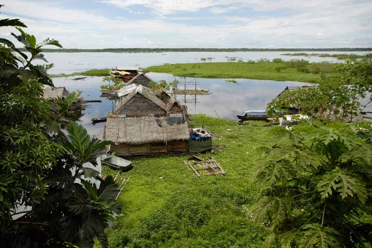 View Looking at Floating Houses and boats over the Itaya River in Iquitos, Peru
