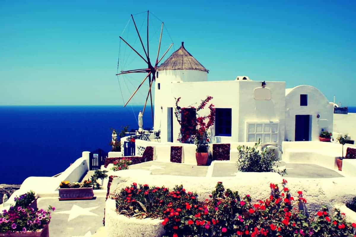 Whitewashed Windmill overlooking ocean in Santorini Greece