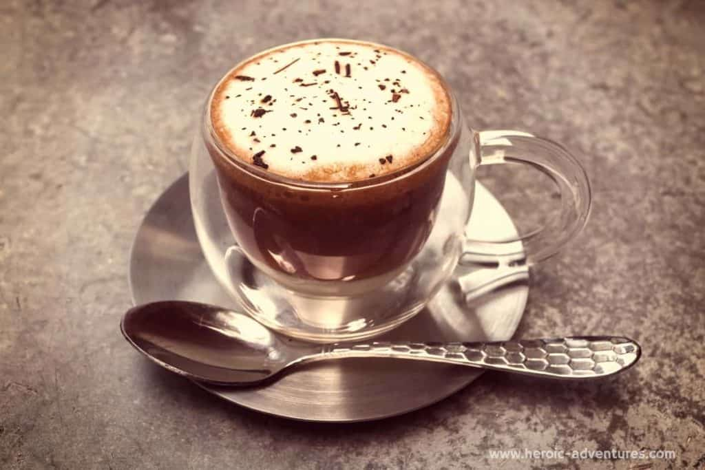 double sided coffee glass with cappuccino and spoon