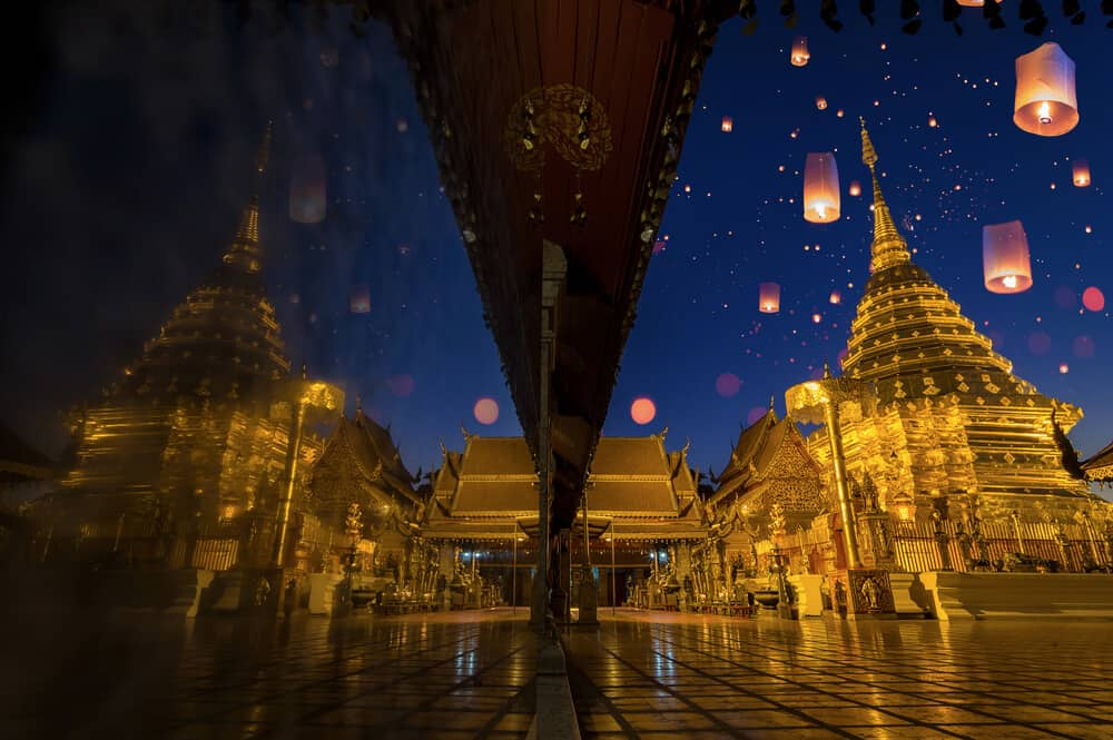 Lanterns in air with Doi Suthep in Background